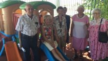 Members of the Mount Isa Hospital Auxiliary try out the new childrens play equipment on the deck of the Childrens Ward