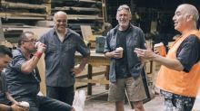 Men talking in a workshop