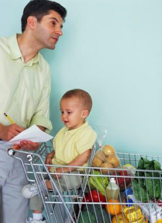 man shopping with his young child