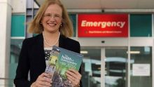 Chief Health Officer Dr Jeanette Young with a copy of the CHO report