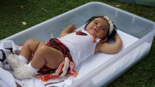 A baby girl lies in a pepi-pod.