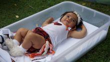 A baby girl lies in a pepi-pod.