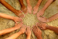 peoples hands forming a circle