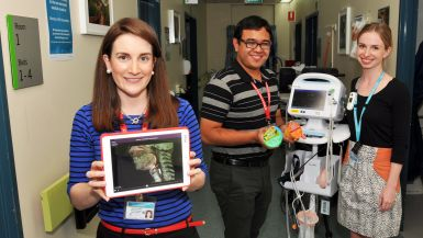 Three Princess Alexandra Hospital speech pathologists demonstrate the equipment they use at work.>