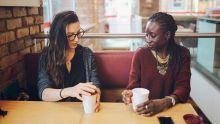 Two people talking in a coffee shop