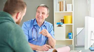 A young man talks to his general practitioner