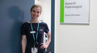 Speech pathologist Grace Whittaker stands at her office door ready for a day of work.