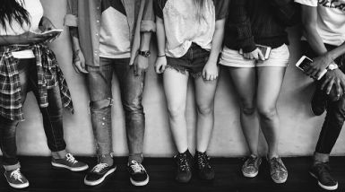 Image of teenage legs symbolic of adolescents at a party