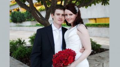 Sharon Smith and her husband pose for a photo on their wedding day.