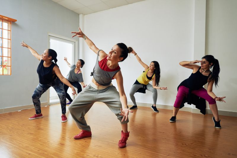 A group of young women take a hip hop dance class.