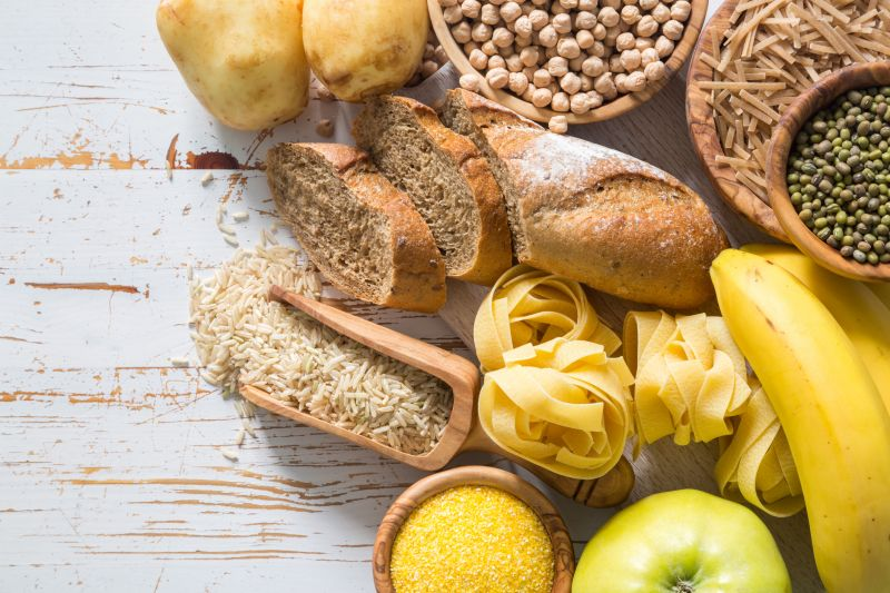 Healthy carbohydrate-rich foods including bread, pasta, rice, potato