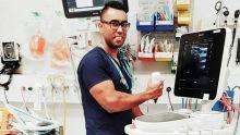 Dr Akmez Latona in the operating theatre