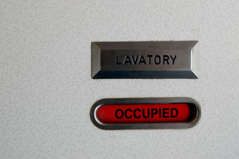 The lock on a toilet door, reading 'occupied'.