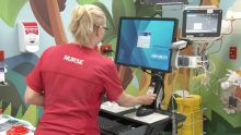 Image of Nurse using Rapid Access Workstations Service