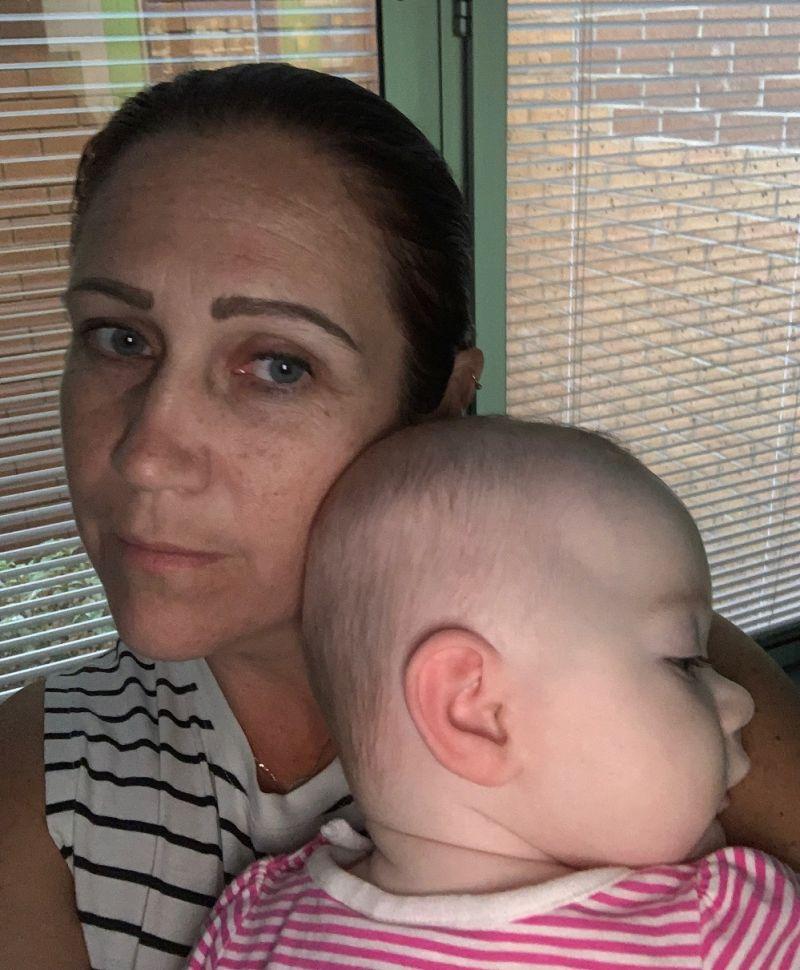 Mel holds Pheobee in hospital
