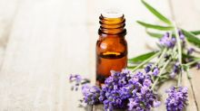 Essential oil bottle with lavender sprigs