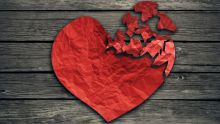Image of broken heart made from red paper
