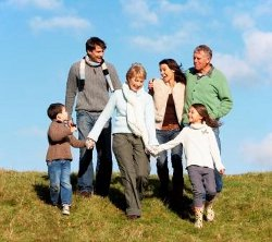 family running down a hill