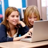 children looking at websites on a laptop