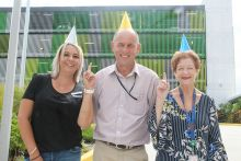 Rockhampton Hospital receptionists Amanda Slater and Jenny Cahill and parking facilities coordinator John Weir are celebrating a year of convenient car parking at the hospital.
